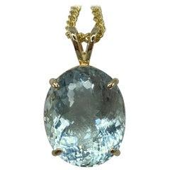 16.94 Carat Fine Blue Aquamarine Fancy Oval Cut Yellow Gold Pendant Necklace