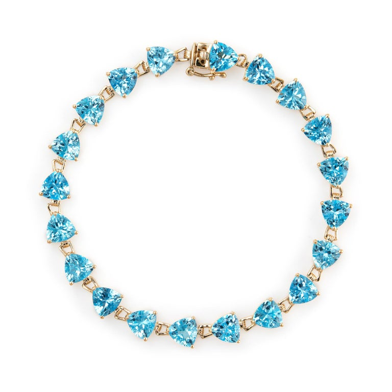 16 Carat Blue Topaz Bracelet Tennis Line Estate 14K Gold Trillion Cut Jewelry In Excellent Condition For Sale In Torrance, CA