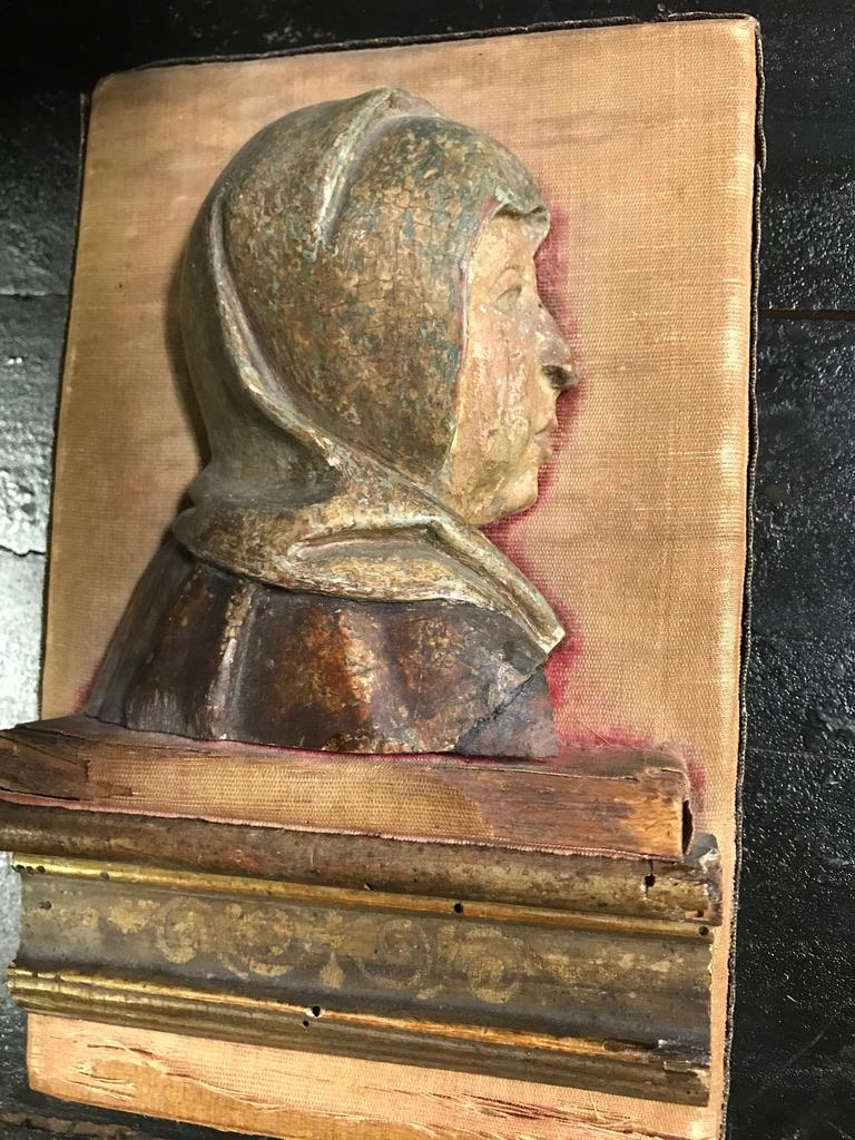 A lovely carved and polychromed wood relief of the Madonna or a female Saint. The face shown in profile with serious expression, perhaps a depiction of Mater Dolorosa from a larger relief. This beautifully caved piece retains much of its original