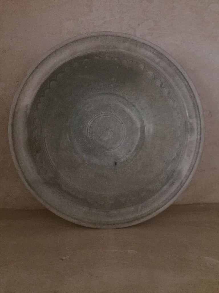 A large Sawankhalok dish with incised geometrical decorations. The Sawankhalok style is perhaps the most know Thai art style from the 15th and 16th century. Its simplicity is elevated by high craftmanship and perfect proportions.  This is a fine