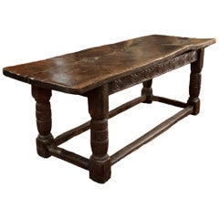 16th Century Tudor Carved Oak Refectory Table with Plank Top and Carved Base