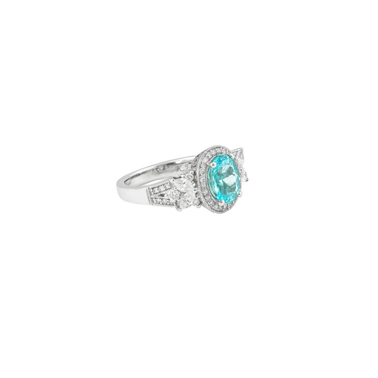 This collection features a selection of the most precious paraibas. This enchanting gemstone is a type of tourmaline sourced from Mozambique and has a beautiful pastel blue-green hue. We have accented this gorgeous gemstone with diamonds set in