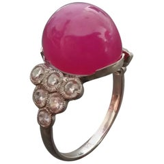 17 Carat Ruby Oval Cabochon 14 Kt Gold 12 Full Cut Round Diamonds Cocktail Ring