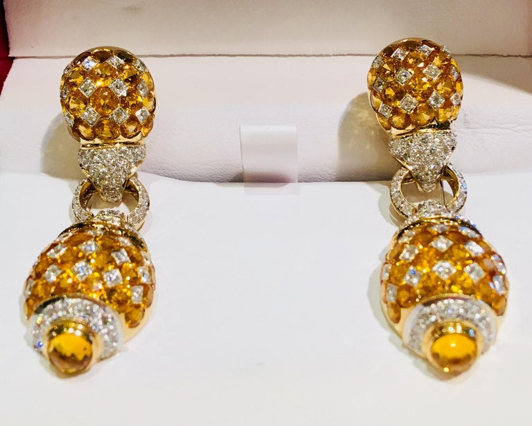 Contemporary 17 Carat Yellow Sapphire and Diamond Harlequin Yellow Gold Door Knocker Earrings For Sale