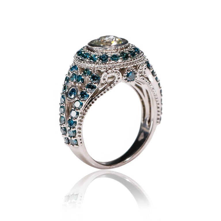 1.7 CT Blue Diamond 0.83 CT White Diamond Cocktail Ring 14KT White Gold   Luxurious in every way, this ring is a stunning example of how you should feel wearing it. Features 0.83 tcw shimmering diamonds aligned together in 1.7 TCW of a deep blue