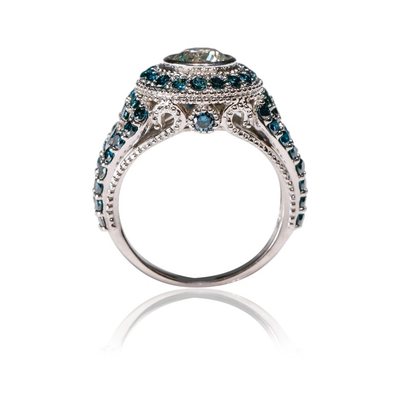 1.7 CT Blue Diamond 0.83 CT White Diamond Cocktail Ring 14 karat White Gold For Sale 1