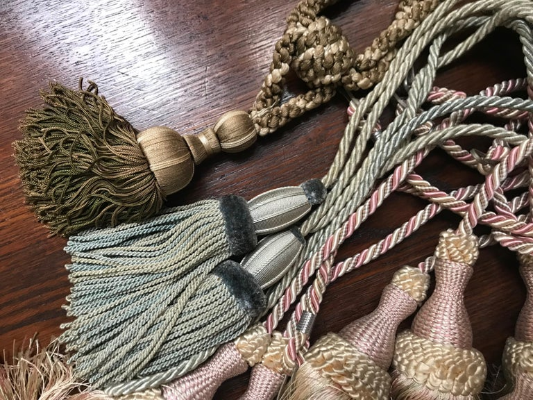 A group of 17 French silk and cotton tasseled curtain tie backs. The largest tassel measures 20 x 5 cm plus the cord.