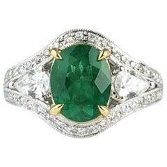 DiamondTown 1.70 Carat Oval Cut Fine Emerald and 0.73 Carat Diamond Ring