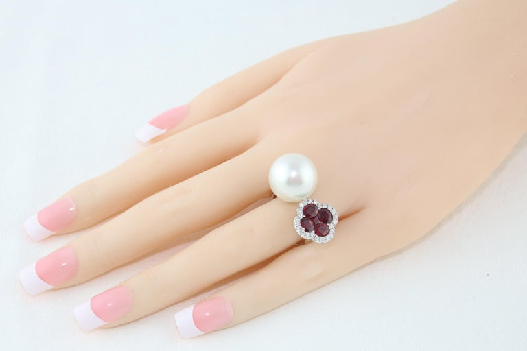 Contemporary 1.70 Carat Ruby and South Sea Pearl Between The Finger Diamond Gold Ring For Sale