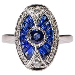1.70 Ct Blue Sapphire 0.26 Carat Diamond Pave 18 Karat White Gold Oval Ring