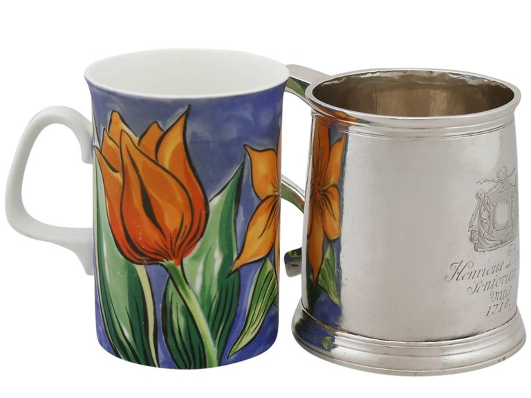 An exceptional, fine and impressive antique Georgian English Britannia standard silver mug; an addition to our 18th century collectable silverware collection.  This exceptional antique George I Britannia silver mug has a cylindrical form onto a