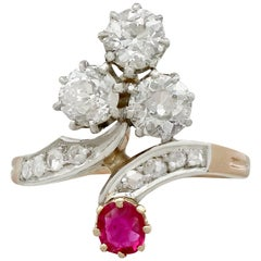 1.71 Carat Diamond and Ruby, Yellow Gold Twist Ring