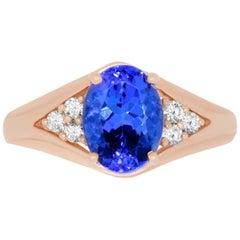 1.71 Carat Oval Shaped Tanzanite and 0.13 Carat Diamond Ring