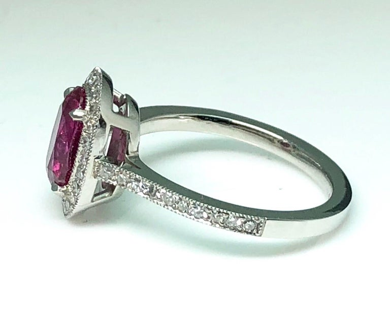 Oval Cut 1.71 Carat Ruby and Diamond Cluster Platinum Ring