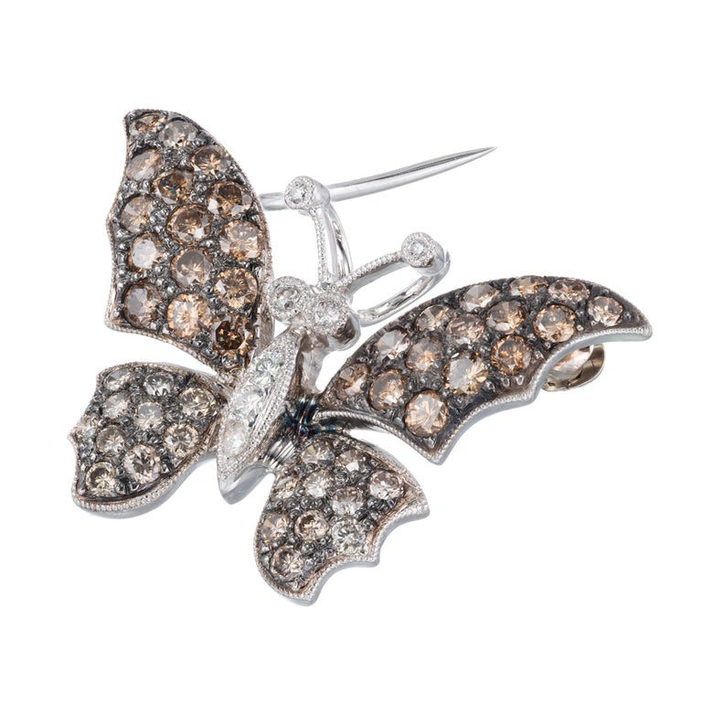 Brown and white diamond Butterfly brooch pendant. Golden brown diamond wings with a white diamond body in 18k white gold.   7 round white diamonds, approx. total weight .08cts 50 round natural golden brown diamonds, approx. total weight 1.64cts, VS