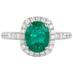 Alexander 1.72 Carat Emerald with Diamond Halo Ring 18 Karat White Gold