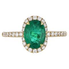 1.73 Carat Emerald Ring with Diamonds in 14 Karat Yellow Gold