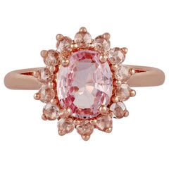 1.73 Carat Padparadscha Sapphire and Diamond Ring Studded in 18 Karat Rose Gold