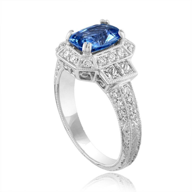 Beautiful Art Deco Revival Oval Cut Milgrain Filigree Ring The ring is 14K White Gold The Center Stone is an Oval Cut Blue Sapphire 1.74 Carats The Sapphire is Heated There are 1.00 Carats in Diamonds F/G VS/SI The ring is a size 6.00, sizable The