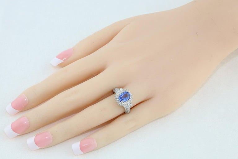 Contemporary 1.74 Carat Blue Sapphire Oval Diamond Gold Milgrain Filigree Ring For Sale