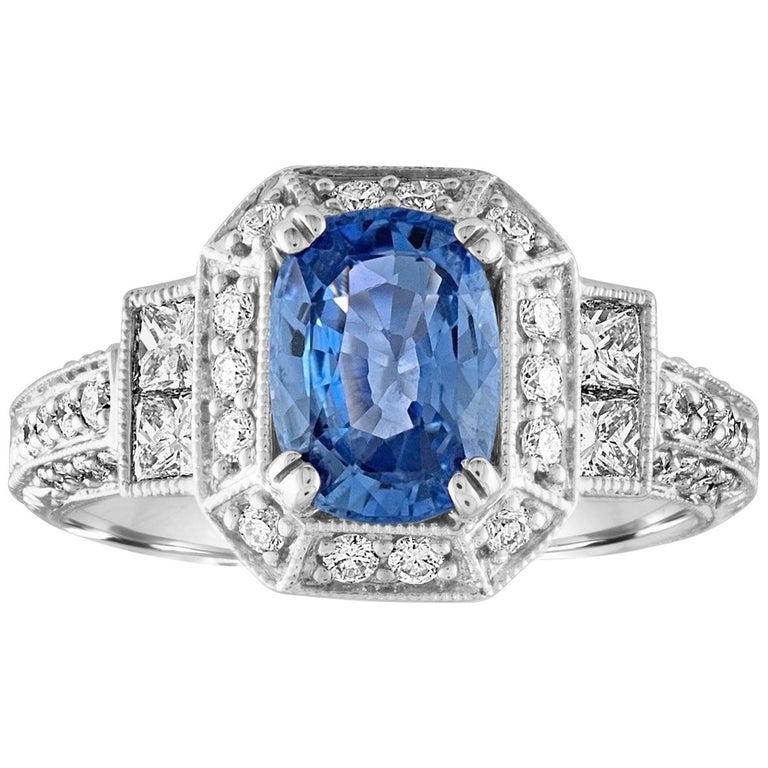 1.74 Carat Blue Sapphire Oval Diamond Gold Milgrain Filigree Ring For Sale
