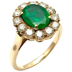 1.74 Carat Natural Oval Emerald and Diamond Rose Gold Ring