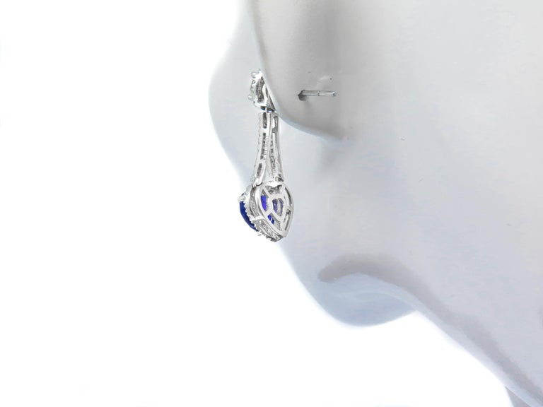 Each sapphire's hue is individual and nuanced; no two are alike. With tones ranging from deep velvety blue to crisp cornflower blue, our blue sapphires are gorgeous specimens of nature's beauty.   These drop earrings feature two round brilliant cut