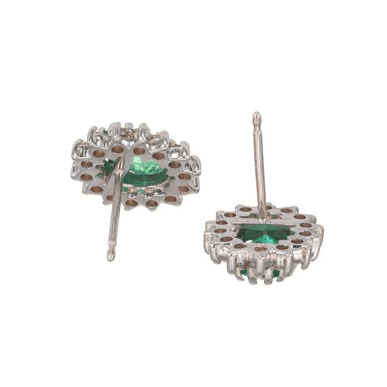 Oval Cut 1.75 Carat Bright Green Oval Emerald Diamond Halo Earrings For Sale