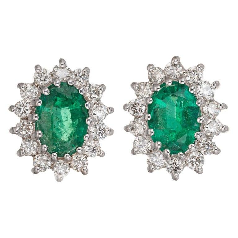 1.75 Carat Bright Green Oval Emerald Diamond Halo Earrings For Sale