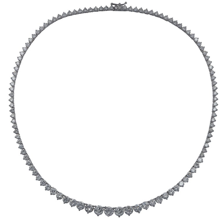 Exquisite graduated diamond riviere  necklace crafted in 18 karat White Gold, showcasing 111 round brilliant cut diamonds weighing approximately 17.5 carats total, G-H color, SI clarity. The diamonds are set in a seamless sea of eternity, creating a