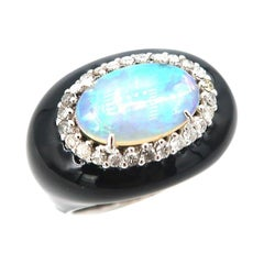1.75 Carat Oval Opal Surrounded by Diamond Black Enameled Oval Shaped Gold Ring