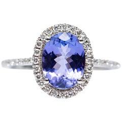 1.75 Carat Oval Tanzanite 0.30 Carat White Diamond 18 Karat Gold Engagement Ring