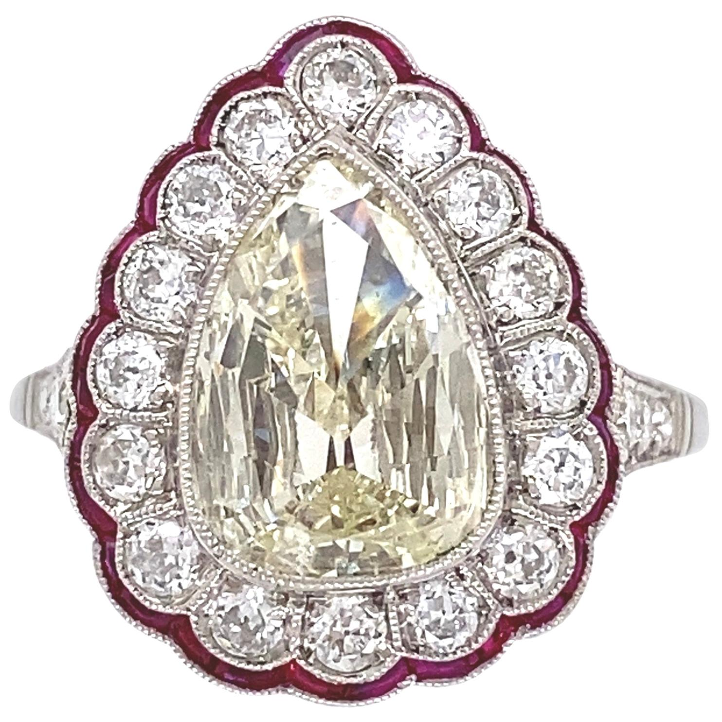 1.75 Carat Pear Diamond and Rubies Platinum Cocktail Ring Estate Fine Jewelry