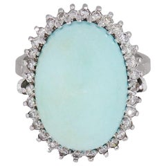 17.63 Carat Oval Cabochon Turquoise and Diamond Halo Ring