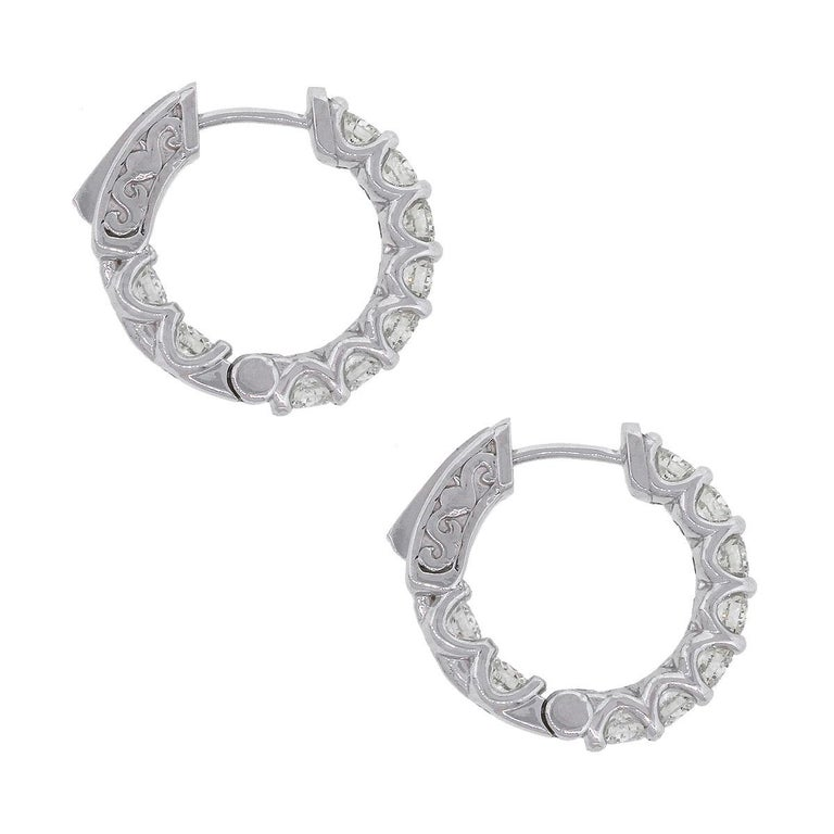 Material: 14k White Gold Style: Diamond Inside Out Hoops Diamond Details: 18 stones, Approximately 0.74ctw of round brilliant diamonds. Diamonds are G/H in color and SI in clarity. Earring Measurements: 0.75″ x 0.11″ x 0.70″ Total Weight: 6g
