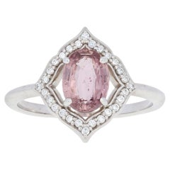 1.77 Carat Oval Cut Padparadscha Sapphire and Diamond Ring, 14 Karat Gold Halo