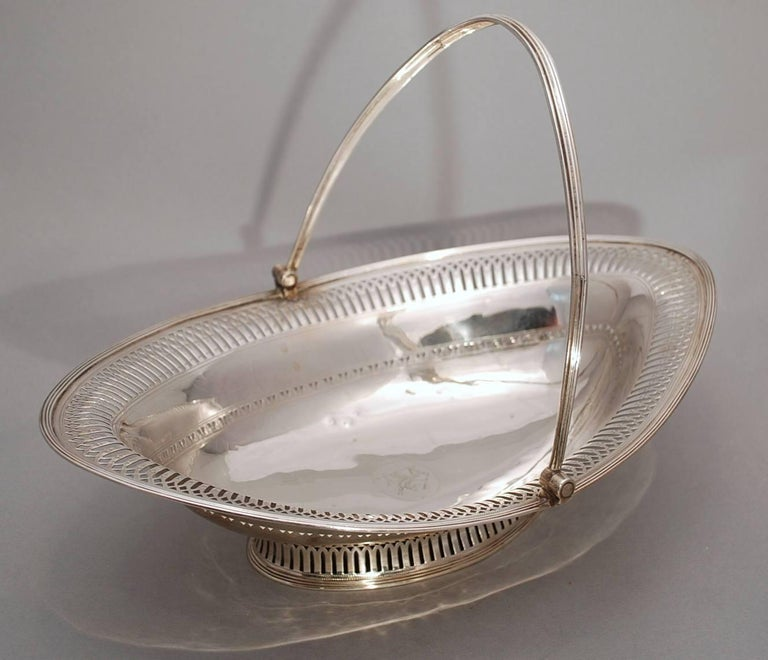Beautiful Georgian sterling silver pierced oval basket made in London, Circa 1796. Swing handle attached to an oval body with a beautifully pierced border around the perimeter sitting on a collet foot. It is fully hallmarked as shown, though the