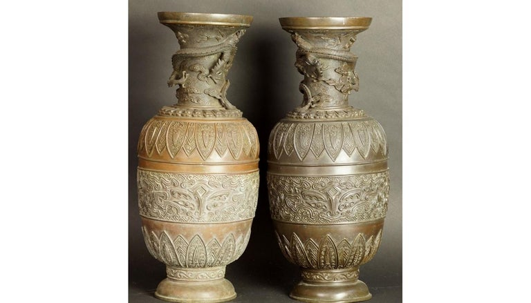 17th-18th century China pair of bronze vases Qing Dynasty A pair of symmetrical decorative vases. Belly with a relief, geometric ornamentation, typical of archaic art. A long neck braided with an almost full-fledged image of the dragon. The dishes