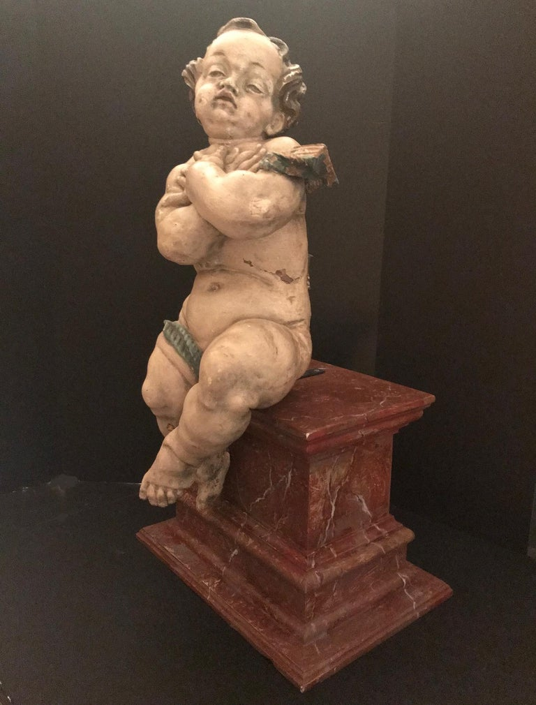 17th Century German Baroque Wood Carved Life Sized Putto, Original Polychrome #1 of 2 For Sale
