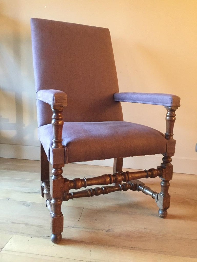 Great 17th century walnut armchair from the Louis XIII period. The proportions and turning quality are exemplary and are complimented with a lovely subtle patina. This armchair has been reupholstered with natural linen.