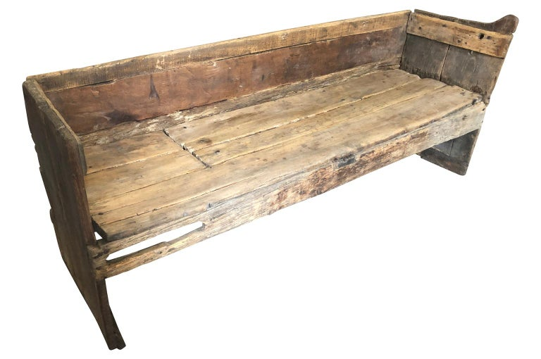 A sensational 17th century primitive bench from the Catalan region of Spain. Beautifully constructed from naturally washed pine and poplar. Super patina. The seat height is 16 5/8