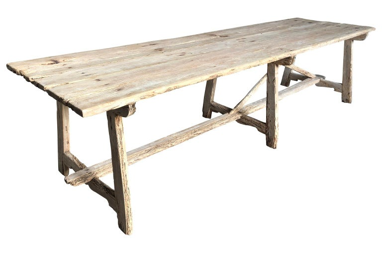 An exceptional grand scale farm table - trestle table from the Catalan region of Spain. Beautifully constructed from apple wood with excellent patina. The table's Minimalist lines blend wonderfully with traditional or modern styling. A perfect table