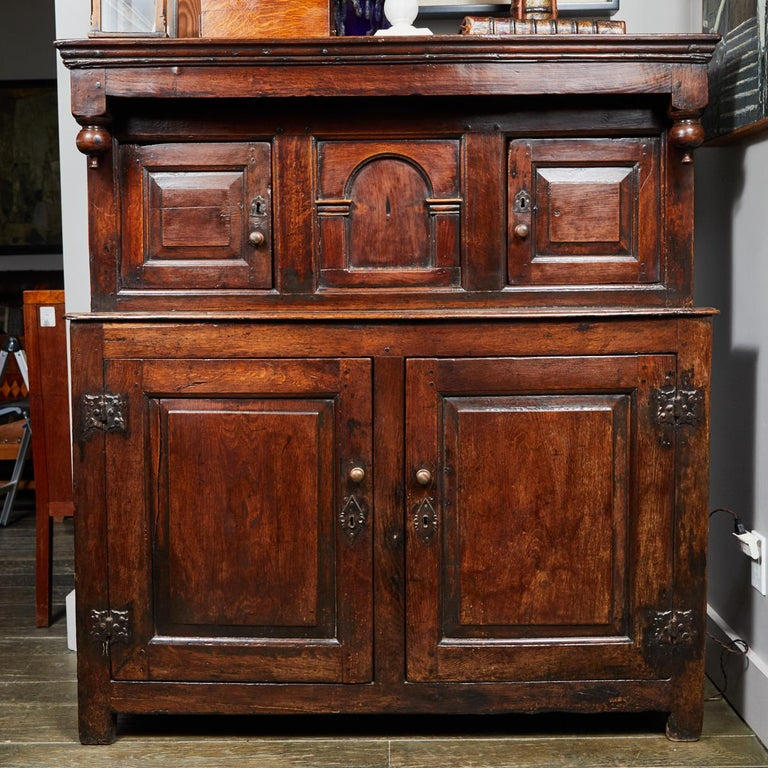 A 17th century paneled court cupboard in oak from the Charles II period in England.