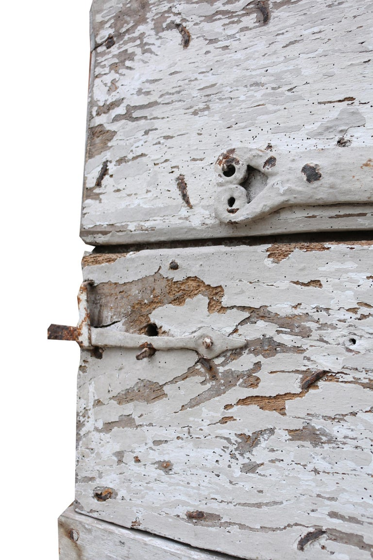 This impressive 17th century exterior door comes from a house associated with Glastonbury Abbey.  This door has wear to the base however is usable and comes with a working latch.  As you would expect for a door of this age, there are signs of