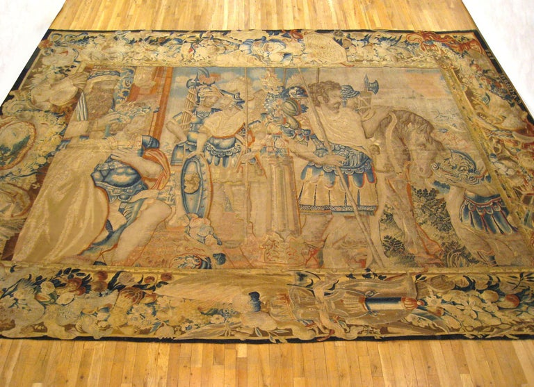 A Flemish mythological tapestry from the 17th century, depicting the Spartan king, Menelaus, seated at left, sending his brother Agamemnon and the Greek troops to Troy to recover his wife, Helen, who had been abducted by Paris, thus starting the