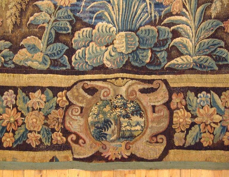 European 17th Century Flemish Verdure Landscape Tapestry, a Lush Forest & Pendant Border For Sale