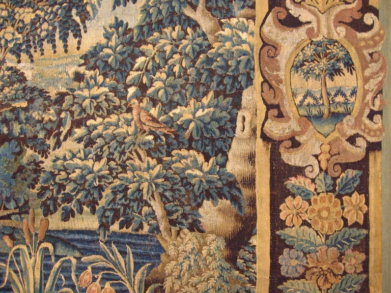 Hand-Woven 17th Century Flemish Verdure Landscape Tapestry, a Lush Forest & Pendant Border For Sale