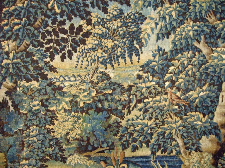 17th Century Flemish Verdure Landscape Tapestry, a Lush Forest & Pendant Border In Good Condition For Sale In New York, NY