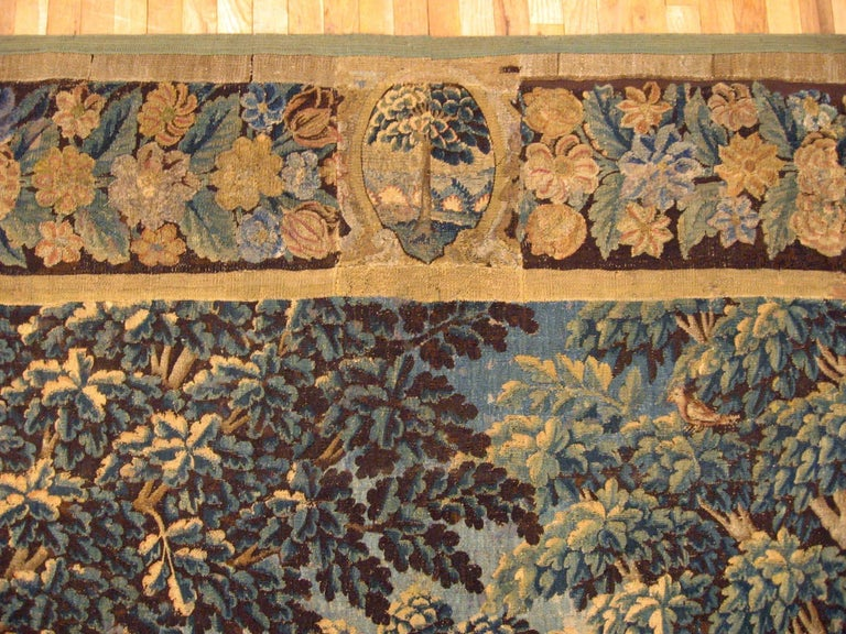 18th Century and Earlier 17th Century Flemish Verdure Landscape Tapestry, a Lush Forest & Pendant Border For Sale