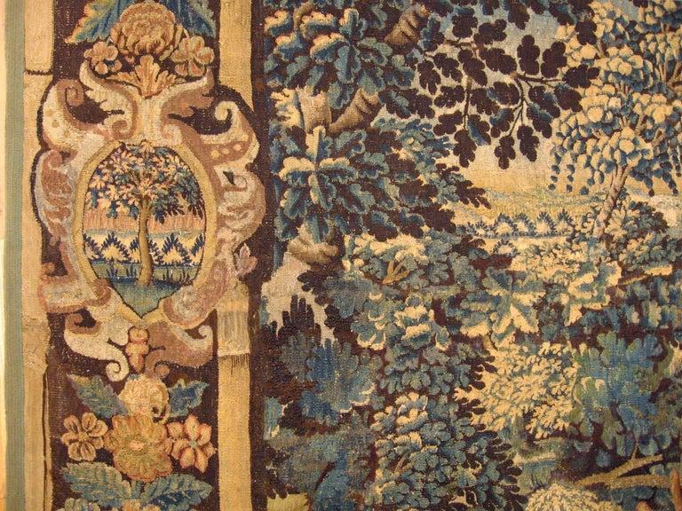 Wool 17th Century Flemish Verdure Landscape Tapestry, a Lush Forest & Pendant Border For Sale